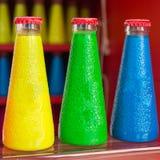 Bebidas coloridas fluorescentes da garrafa do aperitivo Foto de Stock Royalty Free