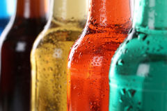 Bebidas da soda com cola em umas garrafas Imagem de Stock Royalty Free