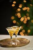 Bebidas de la celebración con las luces Fotografía de archivo