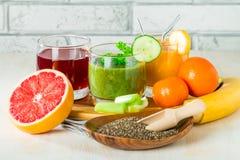 Bebidas verdes, amarelas e vermelhas Fotografia de Stock