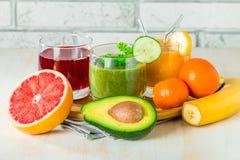 Bebidas verdes, amarillas y rojas Imágenes de archivo libres de regalías