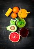 Bebidas verdes, amarillas y rojas Foto de archivo