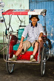 Becak (bicycle taxi) driver in Indonesia Royalty Free Stock Photo