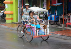 Becak driver and passenger in Makassar, Sulewesi Stock Images