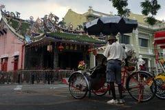 Becek chaufför i Georgetown, Penang, Malaysia Royaltyfri Foto
