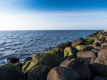 Bech and stone near the ocean. Bech and stone near the Baltic sea Royalty Free Stock Image