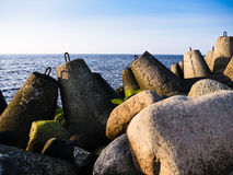 Bech and stone near the ocean Royalty Free Stock Photo