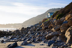 Bech and stone near the ocean. In Malibu Stock Image