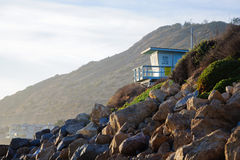 Bech and stone near the ocean. In Malibu Stock Photography