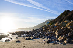 Bech and stone near the ocean. In Malibu Stock Photos