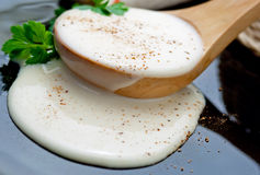 Bechamel sauce. Closeup spoon of  french bechamel sauce Royalty Free Stock Photography