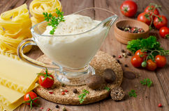 Bechamel sauce with nutmeg. Bechamel sauce for traditional European dishes stock photography