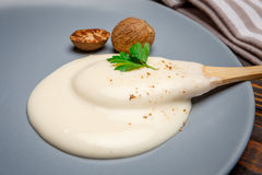 Bechamel sauce on the plate. Traditional bechamel and nutmeg on the plate closeup stock photos