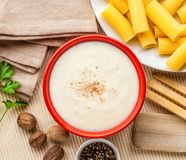 Bechamel sauce. Bechamel white sauce with ingredients, utensils and pasta royalty free stock photos