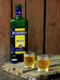 Becherovka bottle and two glasses of an alcoholic beverage Royalty Free Stock Photography