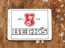 Beck`s beer logo. Logo of beer drinks company Beck`s on samsung tablet on wooden background Stock Images