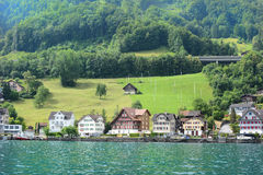 Beckenried Switzerland. BECKENRIED, SWITZERLAND - JULY 4, 2014: Homes and Businesses in Beckenried, Beckenried is located on teh shores of Lake Lucern Royalty Free Stock Images