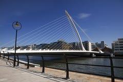 Beckett Bridge In Dublin. Dublin, Ireland - June 2010:  The Samuel Beckett Bridge, designed by Santiago Calatrava, crosses the Liffey River in Dublin. This is Stock Photo