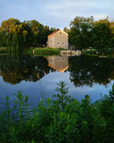 Beckman Mill. In Beloit, Wisconsin with the reflection in the lake. This was taken in the evening and the roof lights were on stock image