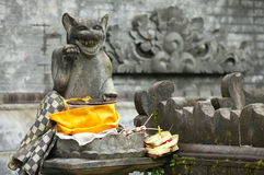 Beckoning cat. At the entrance to hindu temple in Bali, Indonesia royalty free stock images