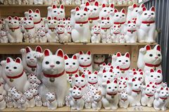 Beckoning cat, Maneki Neko at Gotokuji in temple Tokyo. JAPAN royalty free stock photos