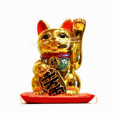 Beckoning cat. On the white background royalty free stock image