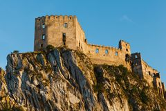 Beckov ruin Castle on a big cliff. stock photo