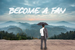 Become a fan against scenic countryside with mountains Stock Images