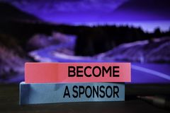 Become A Sponsor on the sticky notes with bokeh background stock image