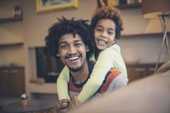 Becoming a father was the best day of my life. African American father and daughter at home. Close up royalty free stock photography