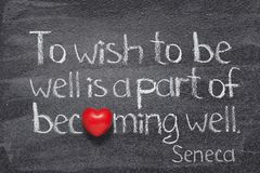 Becoming well Seneca. To wish to be well is a part - quote of ancient Roman philosopher Seneca written on chalkboard with red heart instead of O royalty free stock photography
