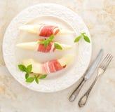 Becon och melon skinka Traditionell spanjormaträtt Arkivfoton