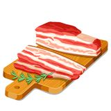 Becon slices with rosemary on wooden cutting board.  Stock Image