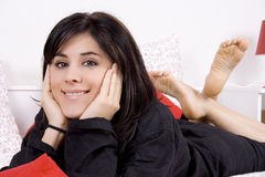 Bed. Young beautiful woman on a bed wearing a black pijama Royalty Free Stock Images