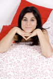 Bed. Young beautiful woman on a bed wearing a black pijama Stock Photography