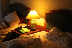 Bed. Hotel bed after use wit lamp Stock Images