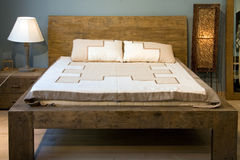 Bed. Room with old-slyle wooden royalty free stock photo
