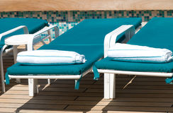 Bed. Chaise-longue near the pool royalty free stock image