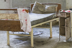 Bed in the abandoned hospital Stock Image