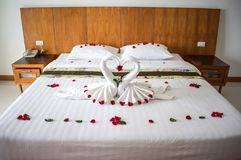 Bed in asian hotel room for lovers Royalty Free Stock Photography