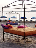 Bed on beach Stock Images