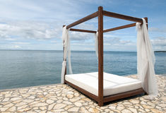 Bed on the beach. Stock Photo
