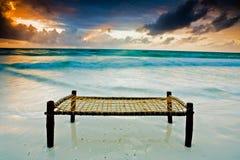 Bed on the beach Stock Photos