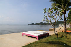 Bed on the beach Stock Images