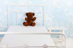 Bed with bear Stock Photography