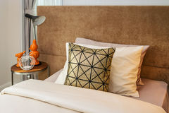 Bed with bedside table lamp Royalty Free Stock Photo