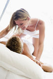 bed being couple lying playful smiling Στοκ Εικόνες