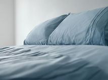Bed With Blue Linen Royalty Free Stock Images