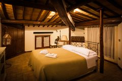 Tuscan Vintage B&B Room. A bed and breakfast bedroom styled as old Tuscan farm housess Stock Images