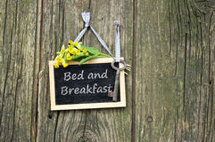 Bed and breakfast. Chalkboard, key and cowslips with lettering bed and breakfast Royalty Free Stock Photos